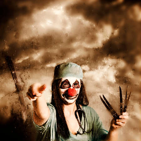throwing knife: Artistic grunge portrait of a scary clown doctor throwing knives outdoors underneath dark storm clouds. Under the knife