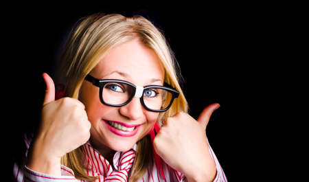 expresses: Over Excited Nerd Expresses Geeky Grin When Thumbing To Black Copyspace With Both Thumbs Up Stock Photo