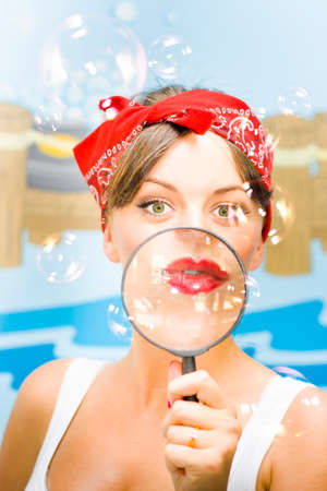 clean home: Cleaning Bubbles Take Flight As A Clean House Inspector Holds Up A Magnifying Glass In A Home Laundry In A Search And Destroy Mission On Germs, Filth And Grime Stock Photo