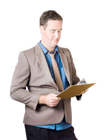 audits: Business man conducting quality control audit when holding a clip board during a routine business inspection Stock Photo