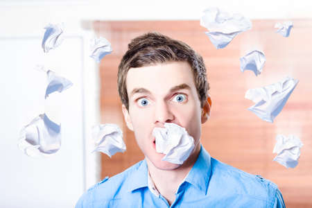 burdensome: Stress crazy businessman drowning in falling paperwork of excess errands. Busy job