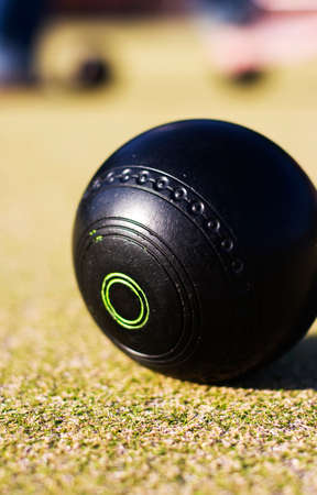 bowl game: Focus On A Lawn Bowls Ball With A Low Depth Of (The) Field Stock Photo
