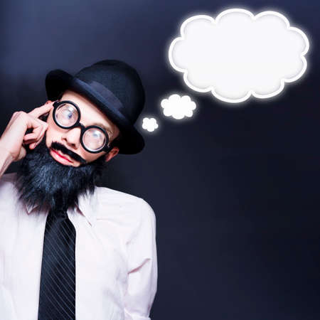 dweeb: Clever Businessman Wearing Geek Glasses Dreaming Up Ideas Of Inspiration With Copyspace Thought Clouds Stock Photo