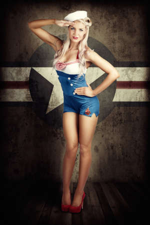 white girl: Grunge Portrait Of A Beautiful American Retro Female Cadet Dressed In Navy Uniform While Saluting In A Military Pin Up Girl Concept On Army Star Background