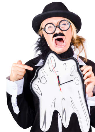 timeframe: A woman in mens clothes and a fake beard with a clock that is melting away Stock Photo