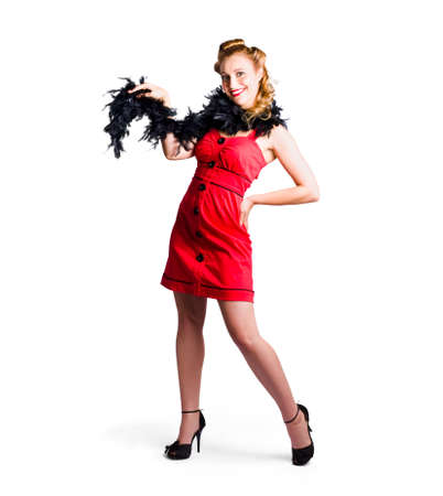 black boa: Female cabaret performer in red dress with retro hairstyle and black feather boa, white background. Stock Photo