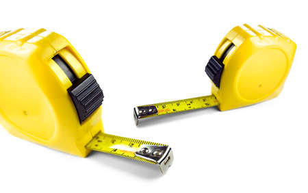 depth measurement: Yellow tape measure showing imperial and metric scale, isolated on white