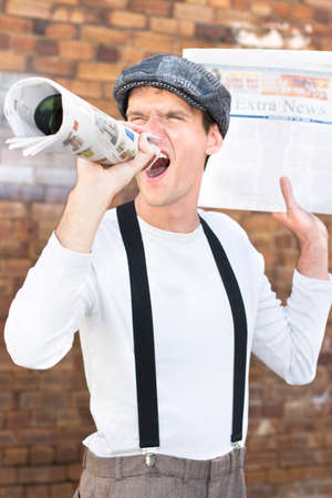 outcry: Paperboy Shouts Out The Latest Through His Rolled Up Newspaper In An Act Of Selling News