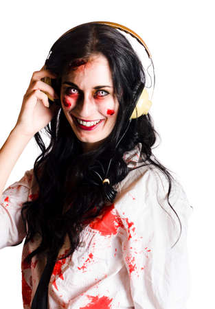 death metal: Smiling woman dress in blood splattered clothes listening to death metal music on headphones