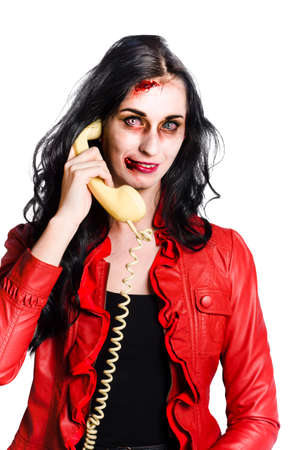 corded: Smiling zombie woman talking on a retro corded telephone