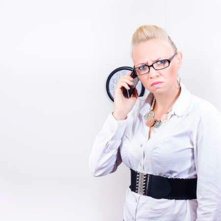 irritable: Upset Businesswoman Holding Smartphone With Irritable Expression In A Work Blues Concept