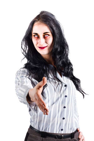 greet eyes: Female zombie with strange smile and staring eyes offers her hand  in welcome isolated on white background. Stock Photo