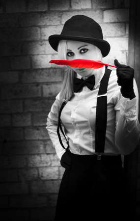 crime solving: In a Black And White Attempt To Catch A Suspect Red Handed A Old Fashioned Detective Discovers A Soft Clue In The Form Of A Red Feather