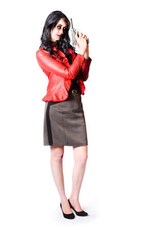 retaliation: Dead female secret agent holding hand gun in killer style while wearing leather jacket and gray skirt isolated on white background Stock Photo
