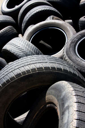 piled: Close-up Image Of Used Rubber Tyres Piled In A Scrap Heap
