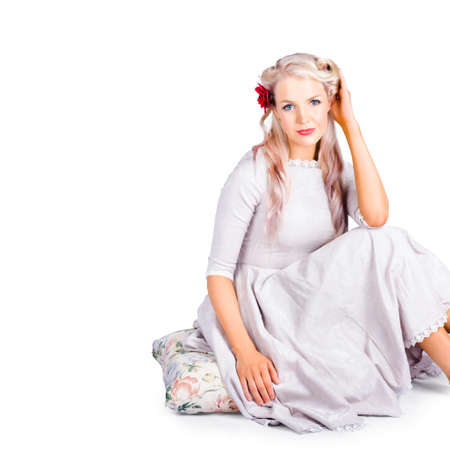 hairpiece: A beautiful woman in a vintage outfit on a white background