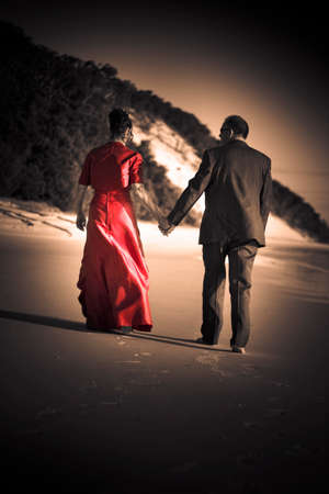 adoring: Romantic Wedding Couple Walk Down The Beach Ready For A Lifetime Of Romance And Love