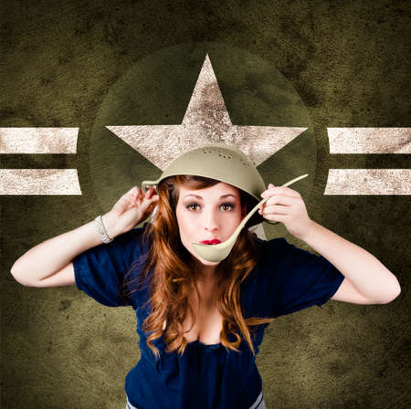estrellas  de militares: Funny vintage portrait of a cute american army pin-up girl cook using strainer for helmet. On military star background Foto de archivo