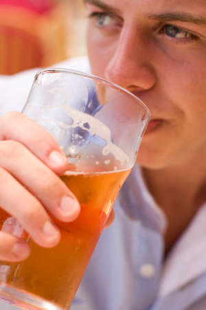 the drinker: Contemplation Consumes The Face Of A Cider Drinker Half Way Though His Pint