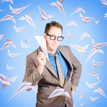 jetset: Business man flying paper aircraft in various directions in an international business travel concept