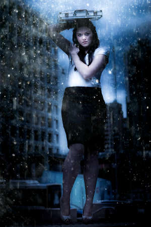 waterfall in the city: Art Design Photo Of A Business Woman On Dark City Street Caught In The Pouring Rain Of A Business Storm In A Metaphor Of Insurance Cover And Financial Dept Crisis Stock Photo