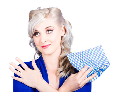 dish cloth: Adorable image of a smiling blonde female pinup cleaner holding a dish cloth while washing away the blues. Housework responsibilities