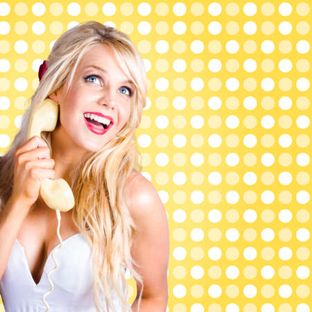 lighthearted: Light-hearted lady listening to telephone gossip with classic fifties long blond hairstyle and make-up. Beauty on call