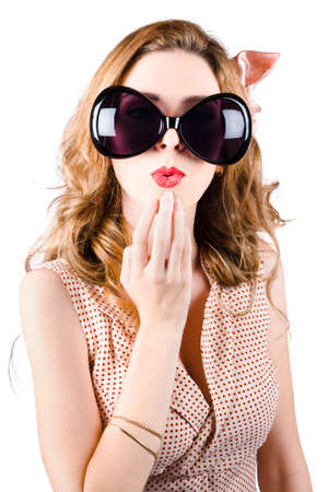 provoking: Humorous portrait of a beautiful pin-up girl wearing oversized sunglasses with surprised expression over white background