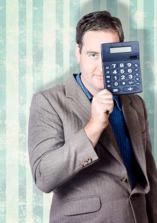 hidden taxes: Business person hiding behind cash calculator when searching for hidden superannuation money