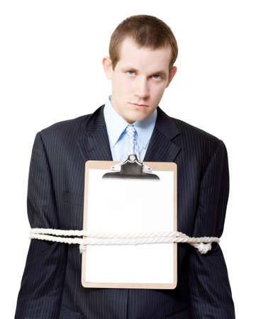 strapped: Serious business man with arms strapped to a binding document with a blank sheet of paper on his chest conceptual of a signed and legalised lock in contract
