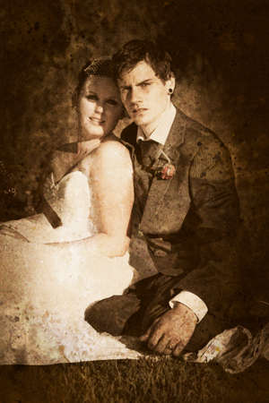the passing of time: Grungy Faded Textured Vintage Wedding Photograph Of A Endearing Couple Embrace Each Others Presence In A Image Depicting Olden Day Nostalgia And Passing Time