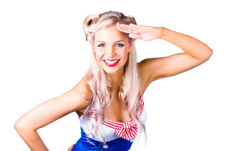 saluting: Sexy young pin-up woman in retro sailor outfit saluting, white background