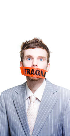 packing tape: Caution Beware Of The Stressed And Dangerous Business Man Or Businessman Wearing Fragile Packing Tape Across Face In A Postage Packing And Delicate Mail Concept