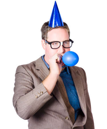 end of year: Geeky male business person blowing up blue balloon during a end of financial year work celebration on white background