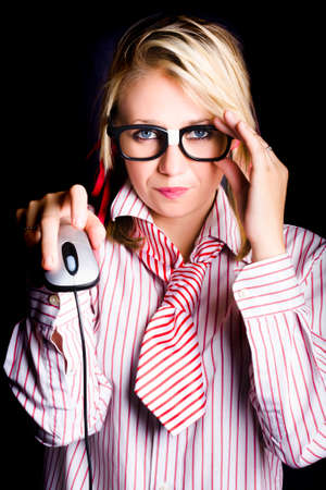 dweeb: Sexy female computer geek clicking a mouse when programming complex code with intellectual thought Stock Photo