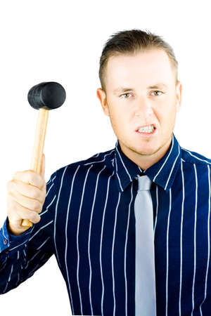 incensed: Irate young man who needs anger management intent on retribution as he raises a mallet in temper and snarls his frustration and disatisfaction Stock Photo