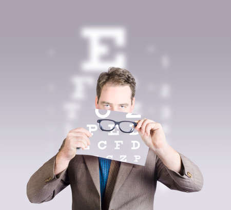 optical: Optometrist or vision doctor holding eye glasses in front of eye examination test chart. Vision impaired concept
