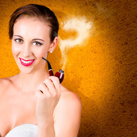 decipher: Elegant woman with pipe, smoking out question when thinking up a solution. Cement background Stock Photo