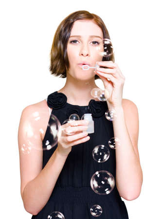 merriment: Happy Young Woman Blowing Dreamy Soap Bubbles In The Air During A Festivity Of Merriment At A Party Celebration, Isolated Studio Portrait On White Background