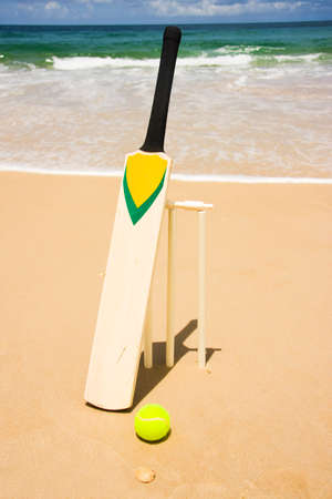 bat and ball: A Bat, Ball & Stumps Setup For A Game Of Beach Cricket