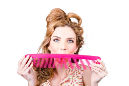 vintage pin up: Funny photograph of a happy pinup woman smiling with hair comb. Retro hairstyle