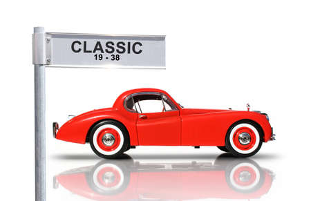of yesteryear: Reflecting On The Streets Of Yesteryear, Red Classic Car