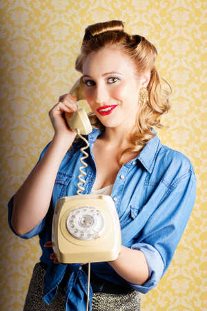 denim skirt: Retro Lady Wearing Denim Shirt And Leopard Print Skirt Chatting On The Home Phone Against Yellow Wallpaper Background