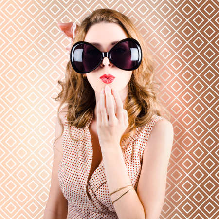oversized: Portrait of beautiful surprised girl wearing big sunglasses holding her hand to face in amazement