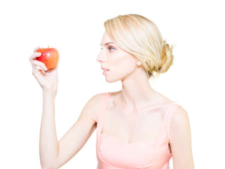 debility: Pale thin undernourished woman who is fading away holding a tempting ripe red apple in her hand convinced that it will cause her to get fat
