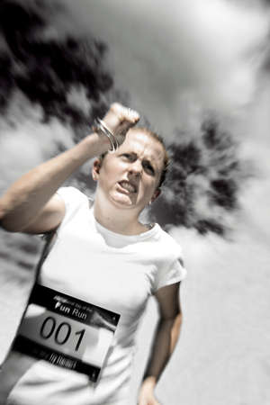 motioning: Marathon Runner Storms Home In Atmospheric Contention During A Sports Triathlon