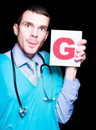 gynaecology: Male Gynaecologist Doctor Holding A Sign With The Letter G For Gynaecology On Black Background