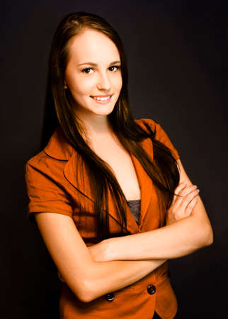 young executive: A smiling self-assured young female corporate executive exudes confidence and trust.