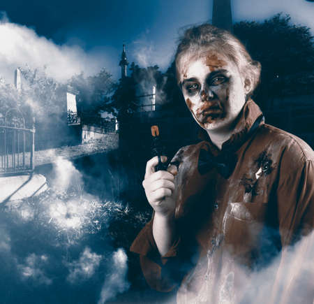 plunder: Cruel monster in foggy cemetery late at night holding gun. Grave robber