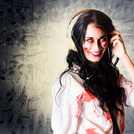 rocker girl: Smiling portrait of a zombie DJ girl listening to gothic rock music in a depiction of a shock rocker